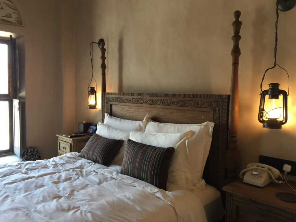 hotel bedroom with lantern bedside lamps