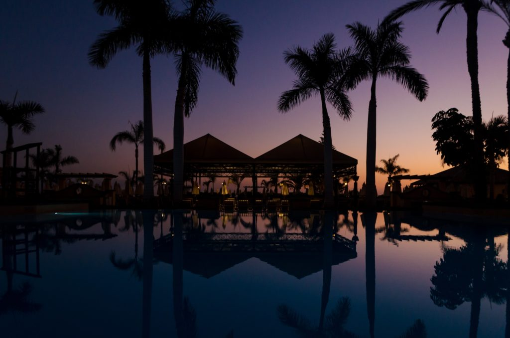 hotel pool area with sunset