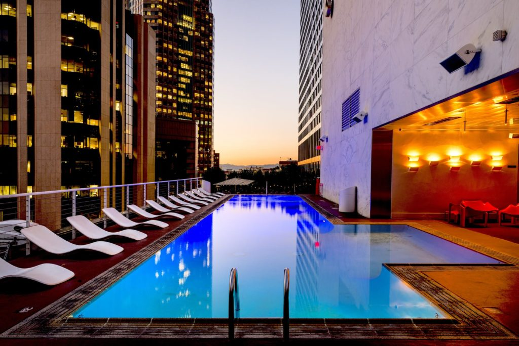 city hotel rooftop pool with sunbeds