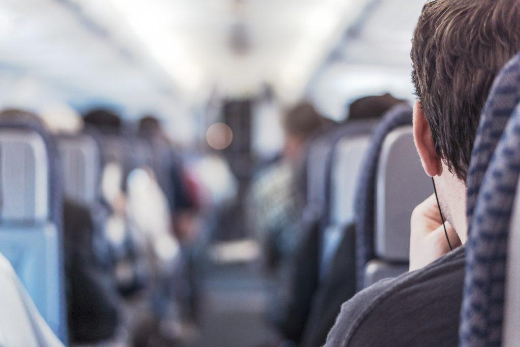 man on plane with headphones
