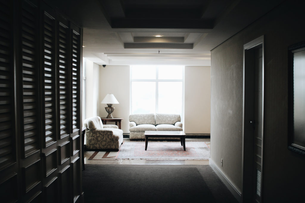 hotel corridor seating area with a large window