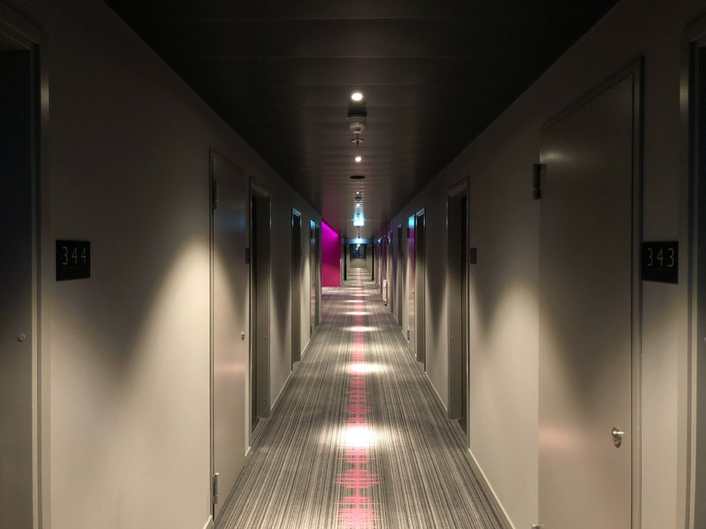 hotel corridor with ceiling lights